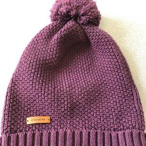 Coach Pom Pom hat. Plum color. Worn once. No snags
